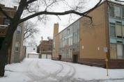 "This is the alley where many children jumped from rooms 208, 210 and 212 on December 1, 1958. Barbara Glowacki's candy store has since been torn down, but originally stood next to the house visible at left. The ""new"" school is somewhat larger than the old school was and covers the old alley, making this alley approximately the same size as the original."